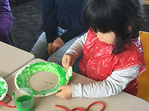 Child making a decorative plate
